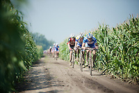 Frederique Robert (BEL/Wanty-Groupe Gobert) leading a group in the infamous cornfield section; leaving no room for manoeuvring (by in-race) cars. <br /> And yes: this is officially a road race!<br /> <br /> 90th Schaal Sels 2015
