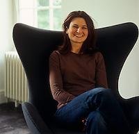 Designer Pip Isherwood sits in an Arne Jacobsen Egg chair