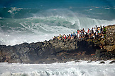 USA, Hawaii, Oahu, group of people watching surfing at Waimea Bay