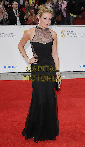 CAT DEELEY.The Philips British Academy Television Awards, Grosvenor house Hotel, Park Lane, London, England, UK, May 22nd 2011..arrivals TV Baftas Bafta full length lace sheer hand on hip maxi clutch bag sleeveless black dress .CAP/CAN.©Can Nguyen/Capital Pictures.