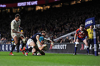 Jack Nowell of England touches down in the corner to score the final try