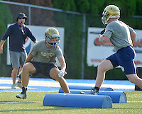NWA Democrat-Gazette/MICHAEL WOODS &bull; @NWAMICHAELW<br /> Shiloh Christian linebacker Lakin Hall runs drills during practice Tuesday August 4, 2015 at Champions Stadium in Springdale.