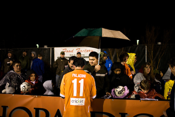 "March 14, 2009. Cary, NC.. The Carolina Railhawks went home in foul weather with a  1-0 victory over the New England Revolution of the MLS, in the inaugural ""Community Shield"" match and their first professional outing under new coach, Martin Rennie. . Railhawks players signed autographs for fans at the end of the game."