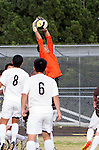 Palos Verdes, CA 01/22/13 - Weston Adkins  (West Torrance #1) in action during the West vs Peninsula boys varsity soccer game at Peninsula High School.