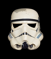 BNPS.co.uk (01202 558833)<br /> Pic: ScreenUsed/BNPS<br /> <br /> One of only seven stormtrooper helmets from their first ever appearance in Star Wars has sold for a stratospheric &pound;178,000.<br /> <br /> This iconic helmet - which was custom-made by the film's production team - was one of only seven completed in time for filming of the Tatooine scenes on location in Tunisia in March 1976. <br /> <br /> They were later called 'Sandtroopers' by fans as they are slightly different to the helmets used for filming subsequent scenes in England.<br /> <br /> This helmet - which must rank amongst the most coveted items for Star Wars collectors - was shockingly thrown in a bin after filming but a crafty crew member rescued it and stored it away for almost 30 years.<br /> <br /> The helmet sold in an online auction at ScreenUsed where is went for three times the estimate.