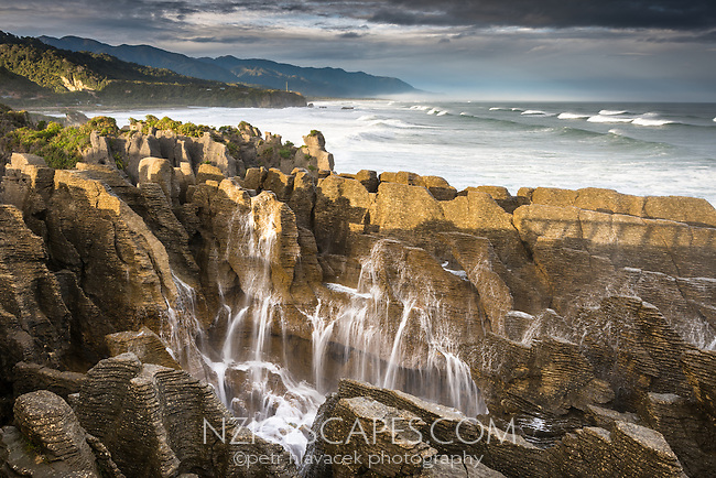 Blowhole at Pancake Rocks, limestone formations in Punakaiki in morning, Paparoa National Park, West Coast, New Zealand