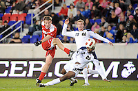 Colin Rolfe (9) of the Louisville Cardinals takes a shot. The Louisville Cardinals defeated the Notre Dame Fighting Irish 1-0 during the semi-finals of the Big East Men's Soccer Championship at Red Bull Arena in Harrison, NJ, on November 12, 2010.