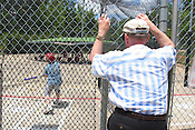 May 25, 2008. Chapel Hill...Steve Pizek watches family member Matthew Junker, 10, take swings at the batting cages at Homestead Park in Chapel Hill on Sunday, May 25th, 2008.