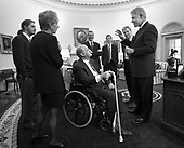 James Brady along with wife Sarah and son Scott meet with United States President Bill Clinton in the Oval Office of the White House in Washington, D.C. moments before dedication of the press office in Brady's honor, February 11, 2000. In the background are John Podesta, Bruce Reed and Joe Lockhart.   Brady Passed away on Monday, August 4, 2014.     <br /> Mandatory Credit: William M. Vasta / White House via CNP