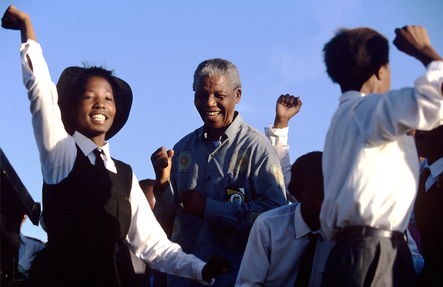 Nelson Mandela dances with school children at a campaign event. After more then 27 years in jail as an anti-apartheid activist,   Nelson Mandela lead a 1994 campaign for President as a member of the African National Congress (ANC),  in the first free elections in South Africa in 1994.  Mandela has received more than 250 awards over four decades, including the 1993 Nobel Peace Prize..