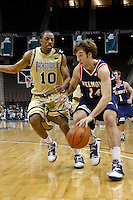February 03, 2011:    Belmont Bruins guard/forward J.J. Mann (14) dribbles past Jacksonville Dolphins forward Ayron Hardy (10) during Atlantic Sun Conference action between the Jacksonville Dolphins and the Belmont Bruins at Veterans Memorial Arena in Jacksonville, Florida.  Belmont defeated Jacksonville 76-70.