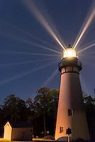 The historic lighthouse on Amelia Island. The lighthouse really comes to life after dark, with beams of light rotating through the night sky.
