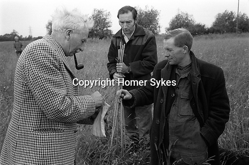 Yarnton Meadow Mowing Rights, Yarnton, Oxfordshire England 1974. Drawing a Mead Ball.  First Monday following St peters day ie in June.Selecting a Mead Ball checking the name that determines which piece of land you will get for the following year.<br />