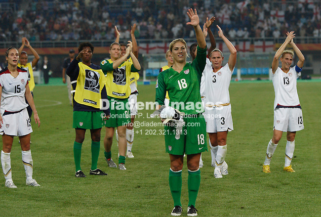 TIANJIN, CHINA - SEPTEMBER 22:  Goalkeeper Hope Solo of the United States (18) and teammates acknowledge supporters after defeating England in a Women's World Cup quarterfinal soccer match September 22, 2007 in Tianjin, China.  (Photograph by Jonathan P. Larsen)