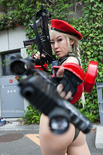 A cosplayer poses for a photograph during the Comic Market 90 (Comiket) event in Tokyo Big Sight on August 12, 2016, Tokyo, Japan. Many manga and anime fans wearing cosplay lined up in the sun for the first day of Comiket. Comiket was established in 1975 and focuses on manga, anime, gaming and cosplay. Organizers expect more than 500,000 visitors to attend this year's summer event which runs for three days until August 14. (Photo by Rodrigo Reyes Marin/AFLO)