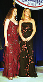 United States President George W. Bush and First Lady Laura Bush's twin daughters Barbara (maroon dress) and Jenna (black dress) at one of the nine inaugural balls in Washington, D.C. on January 20, 2001..Credit: Robert Trippett / Pool via CNP.