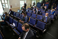 Reporters rise their hands to ask a question as White House Press Secretary Kayleigh McEnany speaks during a press briefing in the James Brady Press Briefing Room of the White House on May 26, 2020 in Washington, DC.<br /> Credit: Oliver Contreras / Pool via CNP/AdMedia