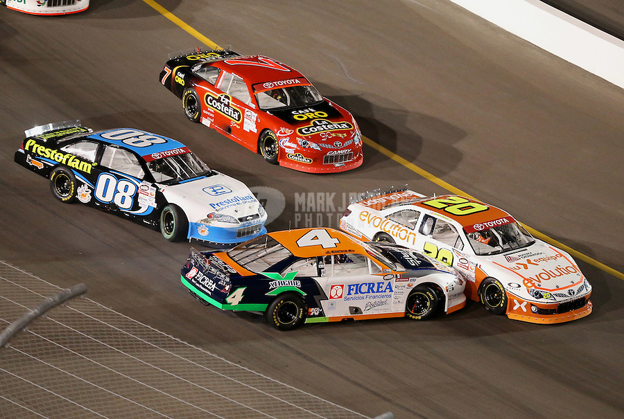 Mar. 1, 2013; Avondale, AZ, USA; NASCAR Mexico Series driver Jorge Goeters (4) and Jose Luis Ramirez (08) spin as Homero Richards (20) and Carlos Peralta (7) go low during the Toyota 120 at Phoenix International Raceway. Mandatory Credit: Mark J. Rebilas-
