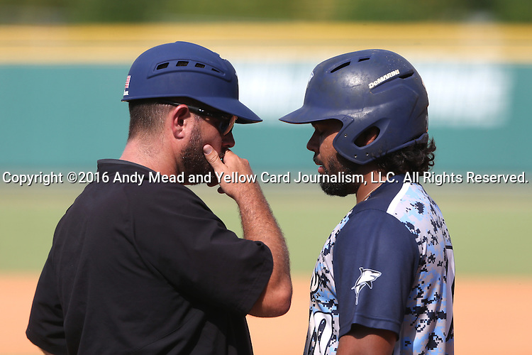 02 June 2016: Nova Southeastern's Andres Visbal (right) with head coach Greg Brown (left). The Nova Southeastern University Sharks played the Cal Poly Pomona Broncos in Game 11 of the 2016 NCAA Division II College World Series  at Coleman Field at the USA Baseball National Training Complex in Cary, North Carolina. Nova Southeastern won the semifinal game 4-1 and advanced to the championship series.