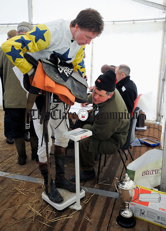 Kieran Shanahan checks the weight of the jockey Hugh O Neill at Bellharbour Point to Point. Photograph by John Kelly.