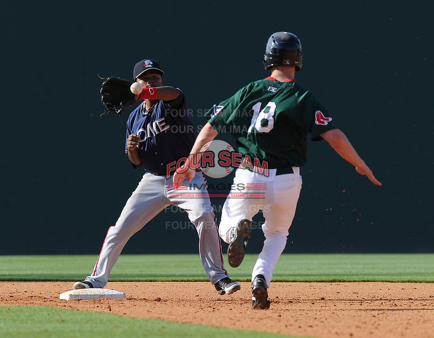 Infielder Elmer Reyes (7) of the Rome Braves makes the putout on Cody Koback (18) of the Greenville Drive in a game on May 6, 2012, at Fluor Field at the West End in Greenville, South Carolina. Greenville won, 11-3. (Tom Priddy/Four Seam Images).2B