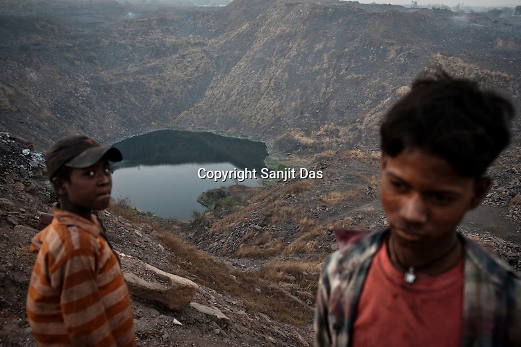 Young boys are seen at the Bokapahari village overlooking the coal mines in Jharia, Jharkhand, India.