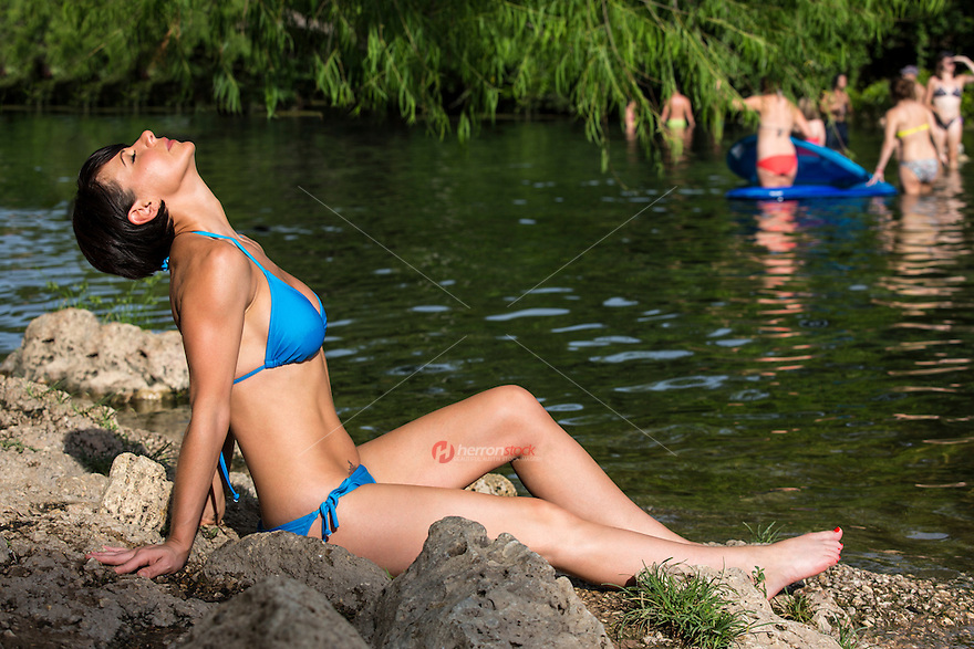 Local Austin woman tanning at Barton Creek swimming pool, a scenic Austin swimming hole and spring-fed creek feeding into Lady Bird Lake.