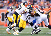 James Harrison #92 of the Pittsburgh Steelers is held by Andrew Whitworth #77 of the Cincinnati Bengals during the game at Paul Brown Stadium on December 12, 2015 in Cincinnati, Ohio. (Photo by Jared Wickerham/DKPittsburghSports)
