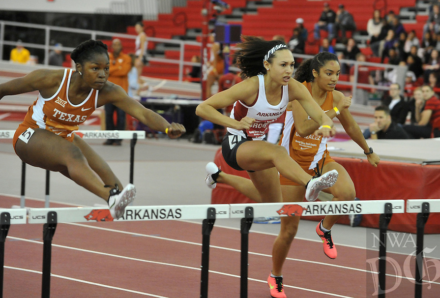 NWA Democrat-Gazette/Michael Woods --01/16/2015-- w @NWAMICHAELW... University of Arkansas runner Taliyah Brooks competes in the women's 60 meter hurdles Friday night during the Arkansas vs. Texas dual track meet at the Randal Tyson Track Center in Fayetteville.