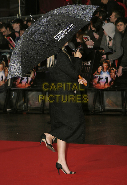 "EDITH BOWMAN.Arrivals at ""Star Wars Episode III: Revenge of the Sith"" UK Premiere, Odeon Cinema Leicester Square, London,.May 16th 2005..full length umbrella raining black microphone back behind logo.Ref: AH.www.capitalpictures.com.sales@capitalpictures.com.©Adam Houghton/Capital Pictures."