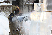 Neighborhood residents were treated to free donuts and ice sculpting demonstrations during a Winter Arts Festival in the Hutchinson Courtyard at the University of Chicago Friday afternoon. 5594, 5614 – Artist, Armand Ramirez of Nadeau Ice Sculptures showed guests how to make a gargoyle.