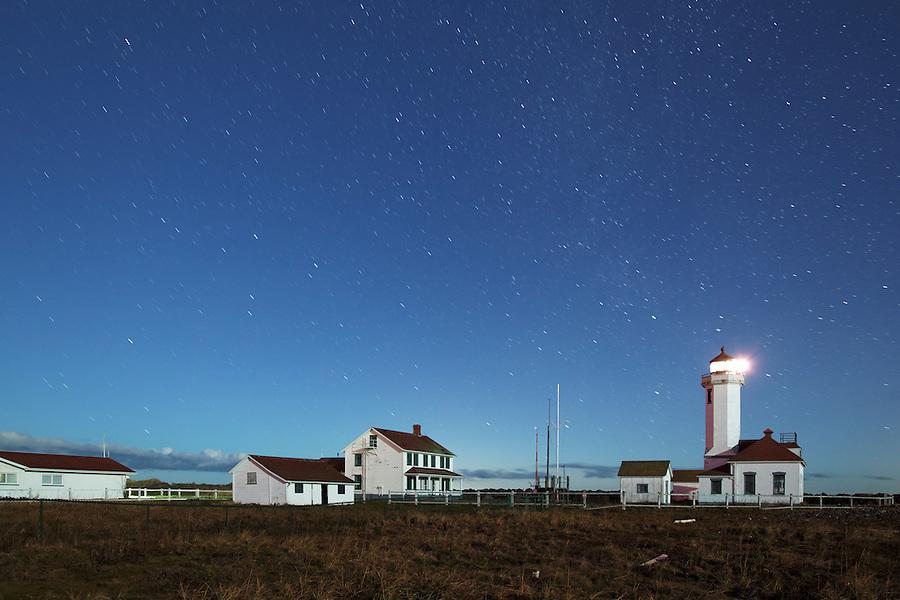 Point Wilson Lighthouse under a starry sky, Fort Worden State Park, Port Townsend, Washington, USA