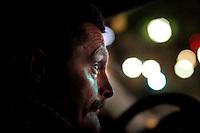 Police officer Stig Gaustad watch Oslo nightlife from an unmarked police car.<br /> <br /> <br /> Stig Gaustad fra Sentrum Politistasjons etteretningsavdeling følger med på utelivet i Oslo sentrum. . (Foto:Fredrik Naumann/Felix Features)