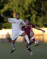 Boston College forward/midfielder Amit Aburmad (7) and Harvard University defender Eric Slingerland (26) battle for the ball. Boston College defeated Harvard University, 2-0, at Newton Campus Field, October 11, 2011.