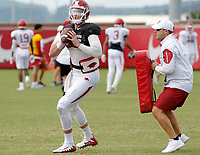 NWA Democrat-Gazette/DAVID GOTTSCHALK University of Arkansas Razorback quarterback Cole Kelley runs through drills Wednesday, August 8, 2018, during football practice on campus in Fayetteville.