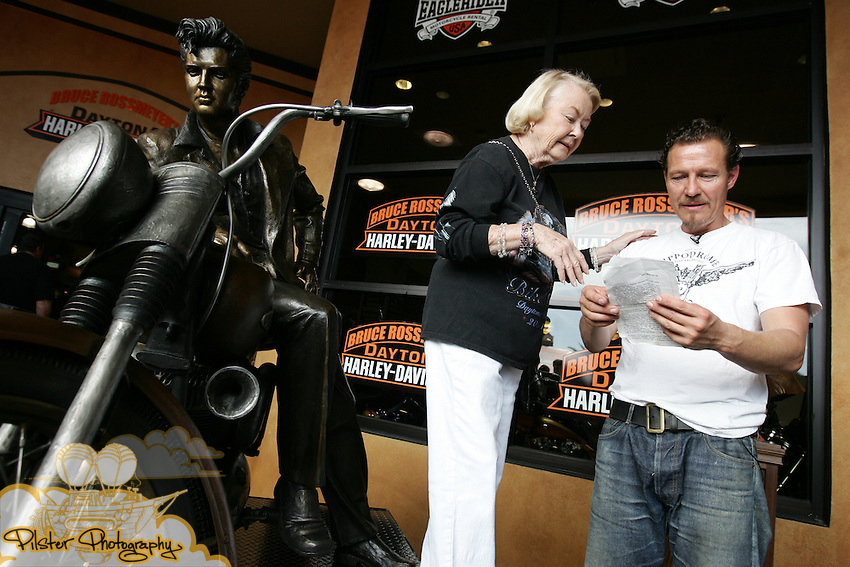 "The  unveiling of a life size Harley-Davidson® ""Elvis Presley on a Motorcycle"" bronze sculpture, by sculptor Jeff Decker on Saturday, February 28, 2009, at Bruce Rossmeyer's Destination Daytona, home of the World's largest Harley-Davidson® dealership, in Ormond Beach. Decker also presented a Rossmeyer bronze bust. (Chad Pilster, PilsterPhotography.com for Zucker Public Relations)"