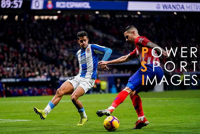 Victor Machin, Vitolo, of Atletico de Madrid (R) fights for the ball with Roberto Jose Rosales Altuve of RCD Espanyol during the La Liga 2018-19 match between Atletico de Madrid and RCD Espanyol at Wanda Metropolitano on December 22 2018 in Madrid, Spain. Photo by Diego Souto / Power Sport Images
