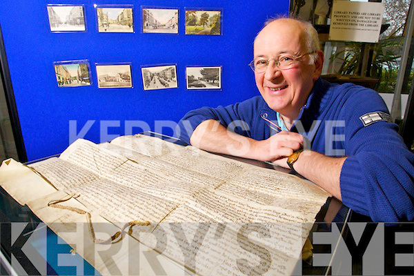 Mike Lynch Archivist of Kerry County Library with theTralee town charter which was written in 1613.