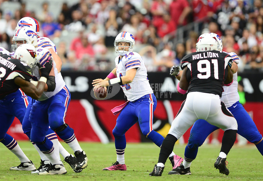 Oct. 14, 2012; Glendale, AZ, USA; Buffalo Bills quarterback (14) Ryan Fitzpatrick against the Arizona Cardinals at University of Phoenix Stadium. The Bills defeated the Cardinals 19-16 in overtime. Mandatory Credit: Mark J. Rebilas-