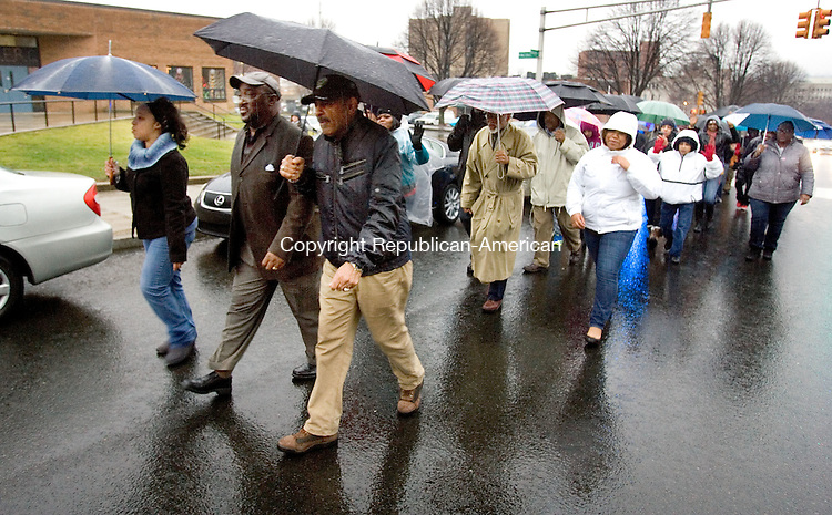 WATERBURY CT. 05 December 2014-120614SV14-About 40 people march up North Elm Street after gathering for a march and rally from Martin Luther King Jr. Memorial Park in Waterbury Saturday. The march was for what they say is unfair treatment of black men across America. <br /> Steven Valenti Republican-American