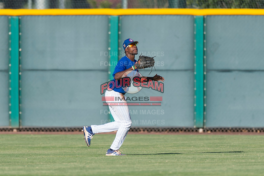 AZL Cubs 1 center fielder Edmond Americaan (22) prepares to catch a fly ball during an Arizona League game against the AZL Indians 1 at Sloan Park on August 27, 2018 in Mesa, Arizona. The AZL Cubs 1 defeated the AZL Indians 1 by a score of 3-2. (Zachary Lucy/Four Seam Images)