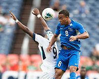 DENVER, CO - JUNE 19: Jordy Delem #8 heads the ball over Maykel Reyes #9 during a game between Martinique and Cuba at Broncos Stadium on June 19, 2019 in Denver, Colorado.