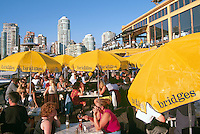 Vancouver, BC, British Columbia, Canada - People dining outdoors at Bridges Restaurant on Granville Island at False Creek, Summer