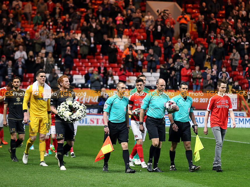 John Palmer, brother of PC Keith Palmer, who recently lost his life in the Westminster terror attack, leads out the two teams during Charlton Athletic vs MK Dons, Sky Bet EFL League 1 Football at The Valley on 4th April 2017
