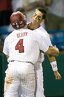 South Carolina 3B Whit Merrifield celebrates with teammate Robert Beary in Game 10 of the NCAA Division One Men's College World Series on June 24th, 2010 at Johnny Rosenblatt Stadium in Omaha, Nebraska.  (Photo by Andrew Woolley / Four Seam Images)