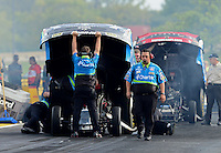 Sept. 28, 2012; Madison, IL, USA: NHRA crew members for funny car driver Tony Pedregon during qualifying for the Midwest Nationals at Gateway Motorsports Park. Mandatory Credit: Mark J. Rebilas-
