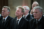 "© Joel Goodman - 07973 332324 . 14/10/2013 . Gorton Monastery , Manchester , UK . Footballers DENIS LAW (c) and GORDON McQUEEN (r) amongst mourners . The Humanist funeral of photographer Harry Goodwin , attended by footballers and other celebrities and featuring music by artists he had photographed including ""He Ain't Heavy, He's My Brother"" by the Hollies and "" Happiness "" by Ken Dodd . Photo credit : Joel Goodman"