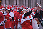 Santa's make a Selfie. SantaCon meet up outside St Pauls Cathedral London UK 2015.