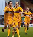 Motherwell's Tom Hateley celebrates after he scores Motherwell's first goal.