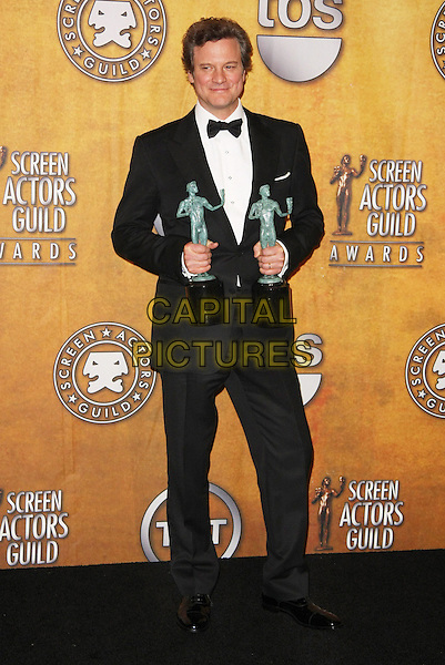 COLIN FIRTH .17th Annual Screen Actors Guild Awards held at The Shrine Auditorium, Los Angeles, California, USA, .30th January 2011..SAG SAGs press room Full length black bow tie tuxedo tux trophies  award trophy winner.CAP/ADM/TB.©Tommaso Boddi/AdMedia/Capital Pictures.